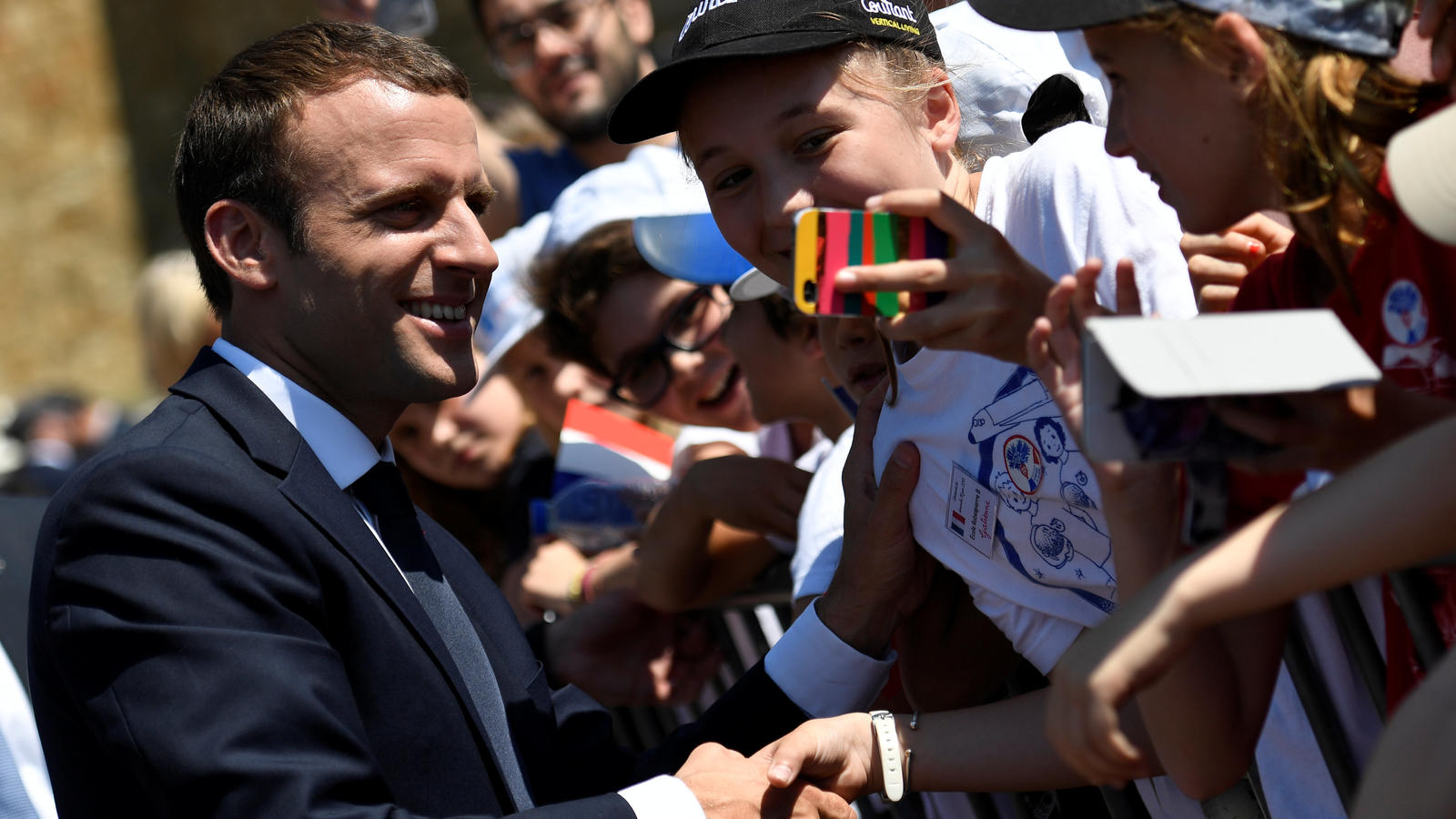 French President Emmanuel Macron (L) attends a ceremony marking the 77th anniversary of late French General Charles de Gaulle's resistance call of June 18, 1940, at the Mont Valerien memorial in Suresnes, near Paris, France, June 18, 2017.  REUTERS/B