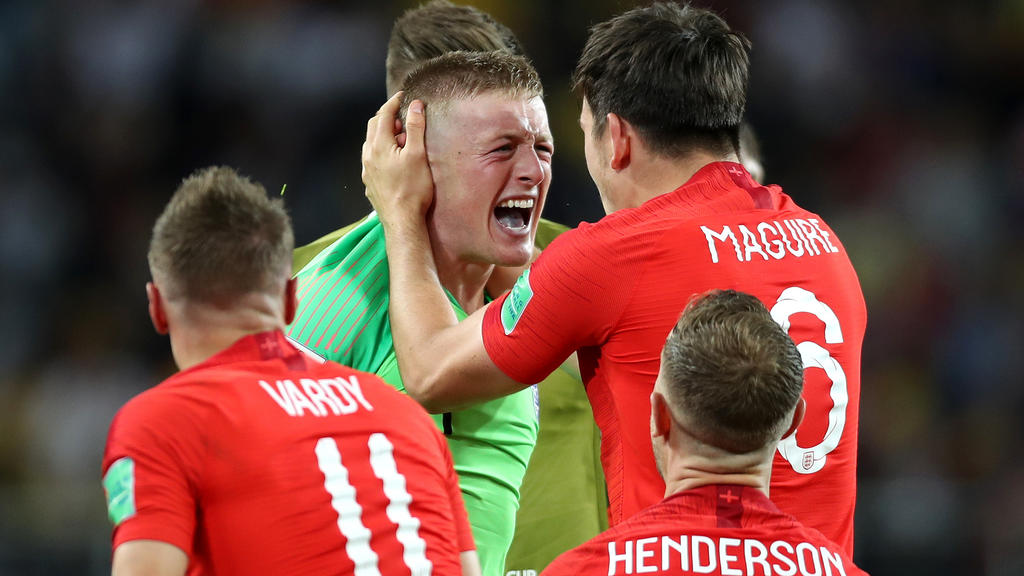MOSCOW, RUSSIA - JULY 03:  Jordan Pickford of England and Harry Maguire of England celebrate following their sides victory in the 2018 FIFA World Cup Russia Round of 16 match between Colombia and England at Spartak Stadium on July 3, 2018 in Moscow,