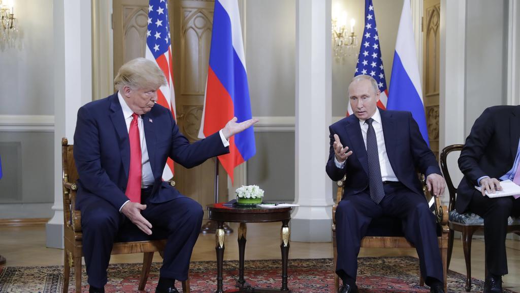 HELSINKI, FINLAND - JULY 16, 2018: US President Donald Trump (L) and Russia s President Vladimir Putin talk during a meeting at the Presidential Palace. Mikhail Metzel/TASS PUBLICATIONxINxGERxAUTxONLY TS089CA7