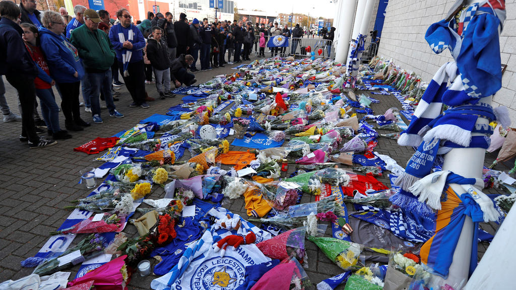 Leicester City football fans pay their respects outside the football stadium, after the helicopter of the club owner Thai businessman Vichai Srivaddhanaprabha crashed when leaving the ground on Saturday evening after the match, in Leicester, Britain,