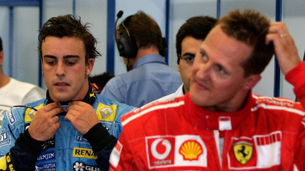 German Formula One driver Michael Schumacher (R) of Scuderia Ferrari and Spanish Fernando Alonso (rear) of Renault F1 team seen after the Qualifying session at the Istanbul Park circuit near Istanbul, Turkey on Saturday; 26 August 2006. Felipe Masa o