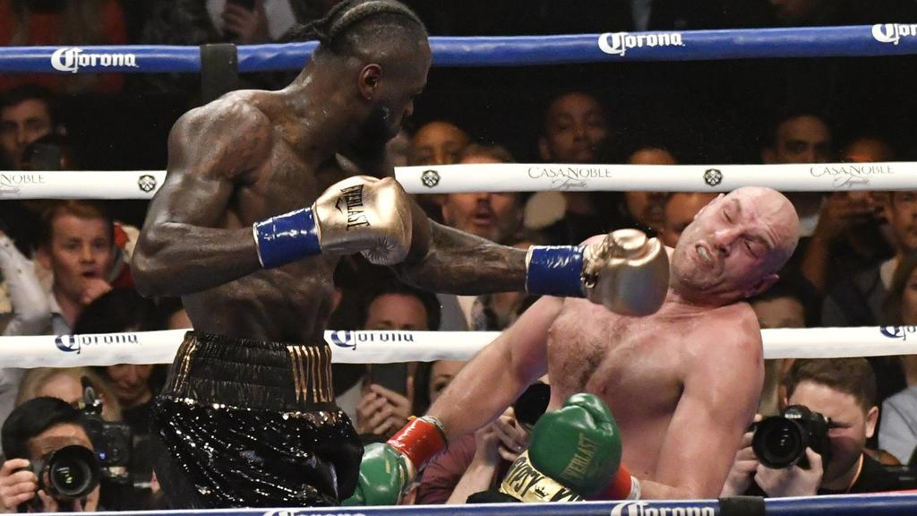 (in color trunks) Deontay Wilder knocks down Tyson Fury a 2nd time in the 12 round at the Staple Center Saturday. The fight was draw between both fighters from the judges scoring . Los Angeles, CA. Dec 1,2018. Wilder-vs-Fury-BOXING PUBLICATIONxINxGER