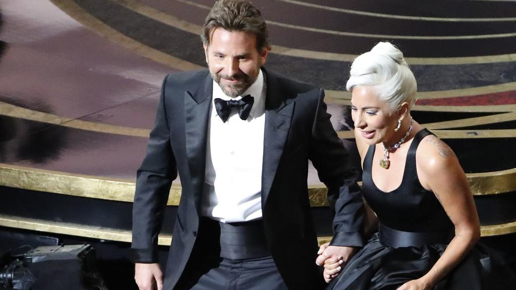 """91st Academy Awards - Oscars Show - Hollywood, Los Angeles, California, U.S., February 24, 2019. Lady Gaga and Bradley Cooper depart the stage after performing """"Shallow"""" from """"A Star Is Born."""" REUTERS/Mike Blake"""