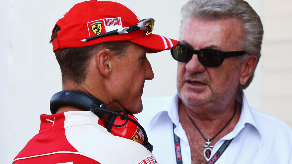 VALENCIA, SPAIN - AUGUST 22:  Former Ferrari F1 World Champion Michael Schumacher (L) talks to his manager Willi Weber during the final practice session prior to qualifying for the European Formula One Grand Prix at the Valencia Street Circuit on Aug
