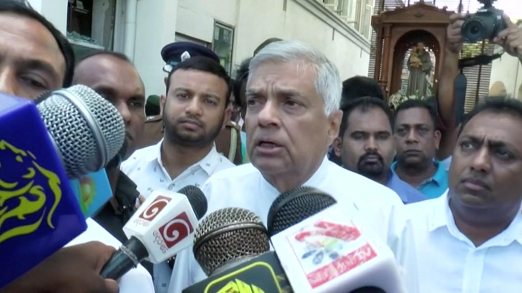 Sri Lanka's Prime Minister Ranil Wickremesinghe speaks to media at St. Anthony's Shrine in Colombo, Sri Lanka, April 21, 2019 in this still image obtained from a video. Derana TV/via Reuters TV   THIS IMAGE HAS BEEN SUPPLIED BY A THIRD PARTY. MANDATO