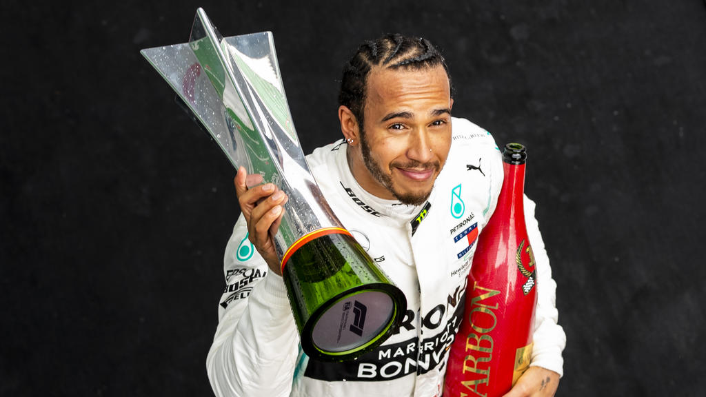 SHANGHAI, CHINA - APRIL 14: Race winner Lewis Hamilton of Great Britain and Mercedes GP celebrates on the podium during the F1 Grand Prix of China at Shanghai International Circuit on April 14, 2019 in Shanghai, China. (Photo by Mark Thompson/Getty I