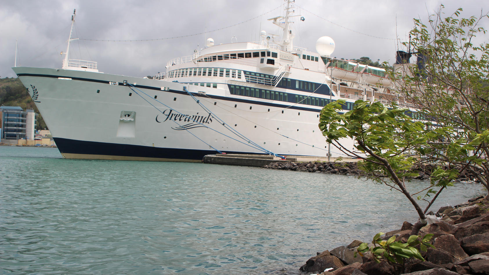 A 440-foot ship owned and operated by the Church of Scientology SMV Freewinds docked under quarantine from a measles outbreak in port near Castries St. Lucia