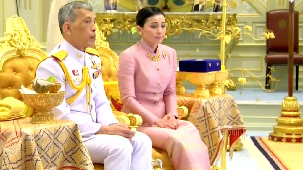 King Maha Vajiralongkorn and his consort, General Suthida Vajiralongkorn named Queen Suthida attend their wedding ceremony in Bangkok, Thailand May 1, 2019, in this screen grab taken from a video. Thai TV Pool  THAILAND OUT. NO COMMERCIAL OR EDITORIA