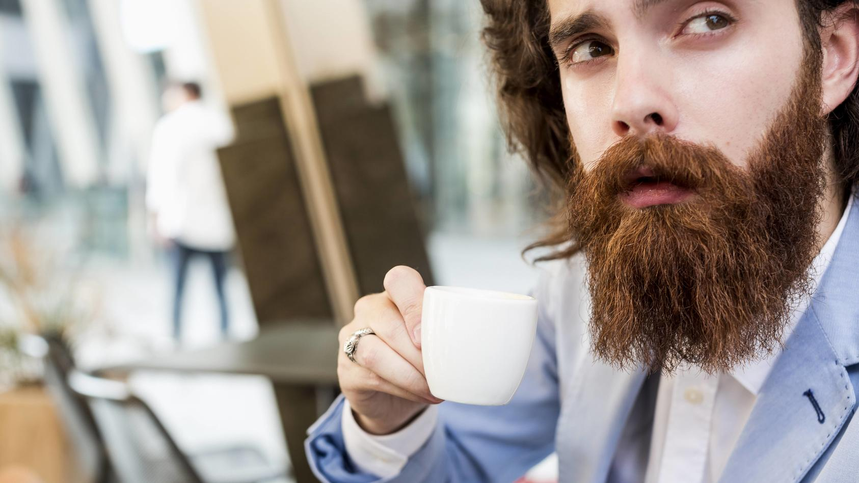 Stylish businessman drinking espresso in a cafe model released Symbolfoto PUBLICATIONxINxGERxSUIxAUT