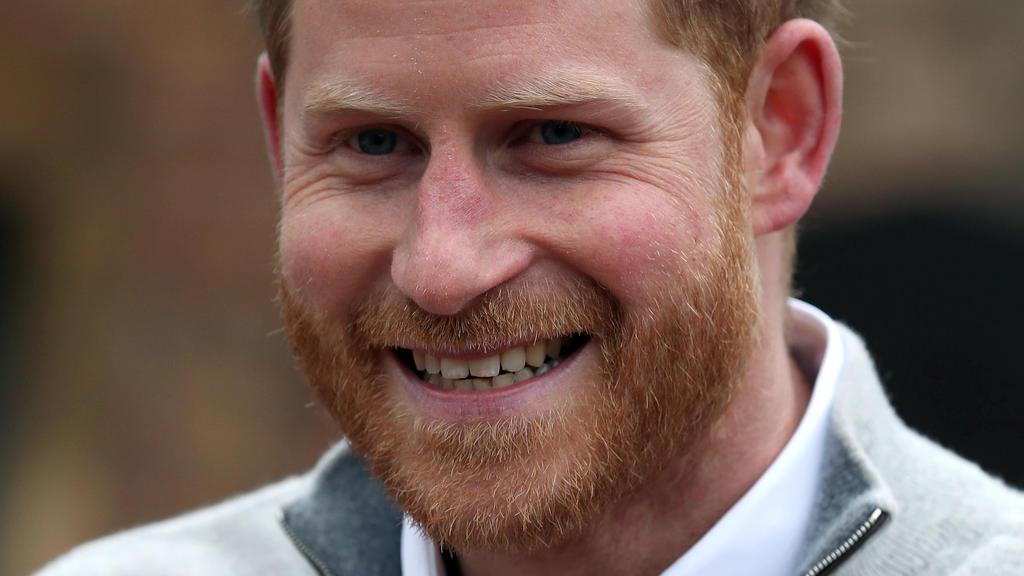 Prinz Harry lacht glücklich