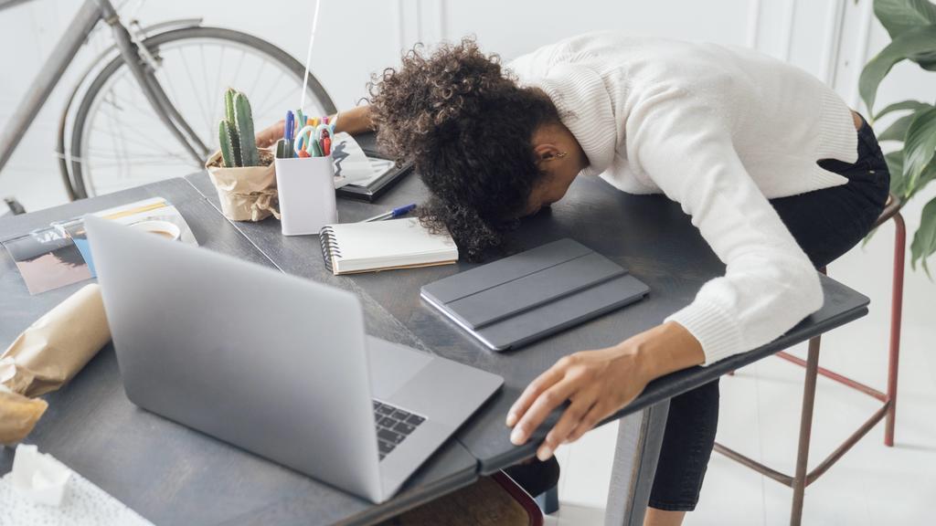 Tired freelancer sleeping on her deak model released Symbolfoto property released PUBLICATIONxINxGERxSUIxAUTxHUNxONLY BOYF00941