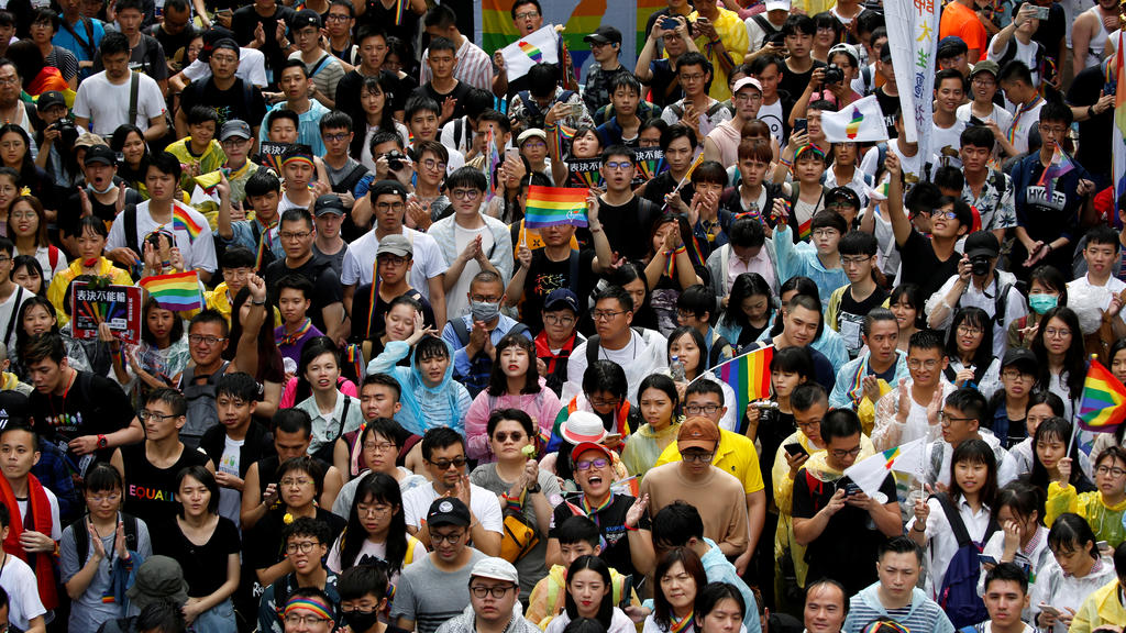 Same-sex marriage supporters hold umbrellas and rainbow flags as they take part in a rally during a parliament vote on three different draft bills of a same-sex marriage law, outside the Legislative Yuan in Taipei, Taiwan May 17, 2019. REUTERS/Tyrone