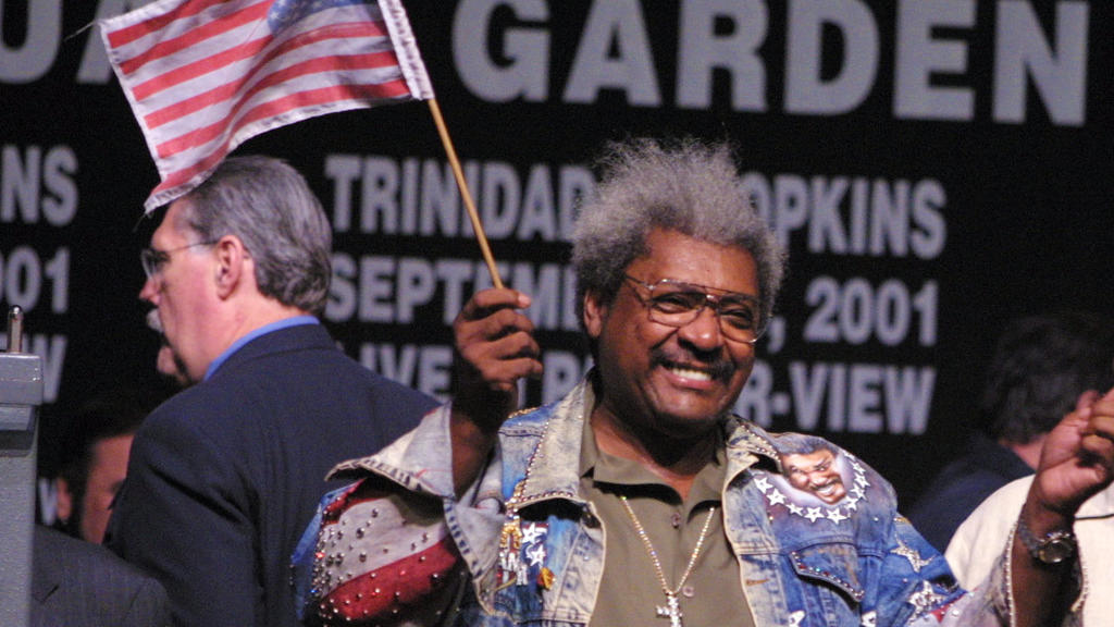 28 Sep 2001:  Don King holds up American flags at the Bernard Hopkins vs Felix Trinidad weigh in for the middleweight unification fight  at Madison Square Garden in New York City.  DIGITAL IMAGE  Mandatory Credit: Al Bello/ALLSPORT