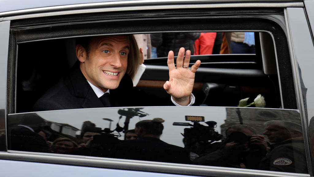 French President Emmanuel Macron waves to the crowd as he leaves by car after casting his ballot as part of the vote for the European parliamentary election in Le Touquet, France May 26, 2019. Ludovic Marin/Pool via REUTERS