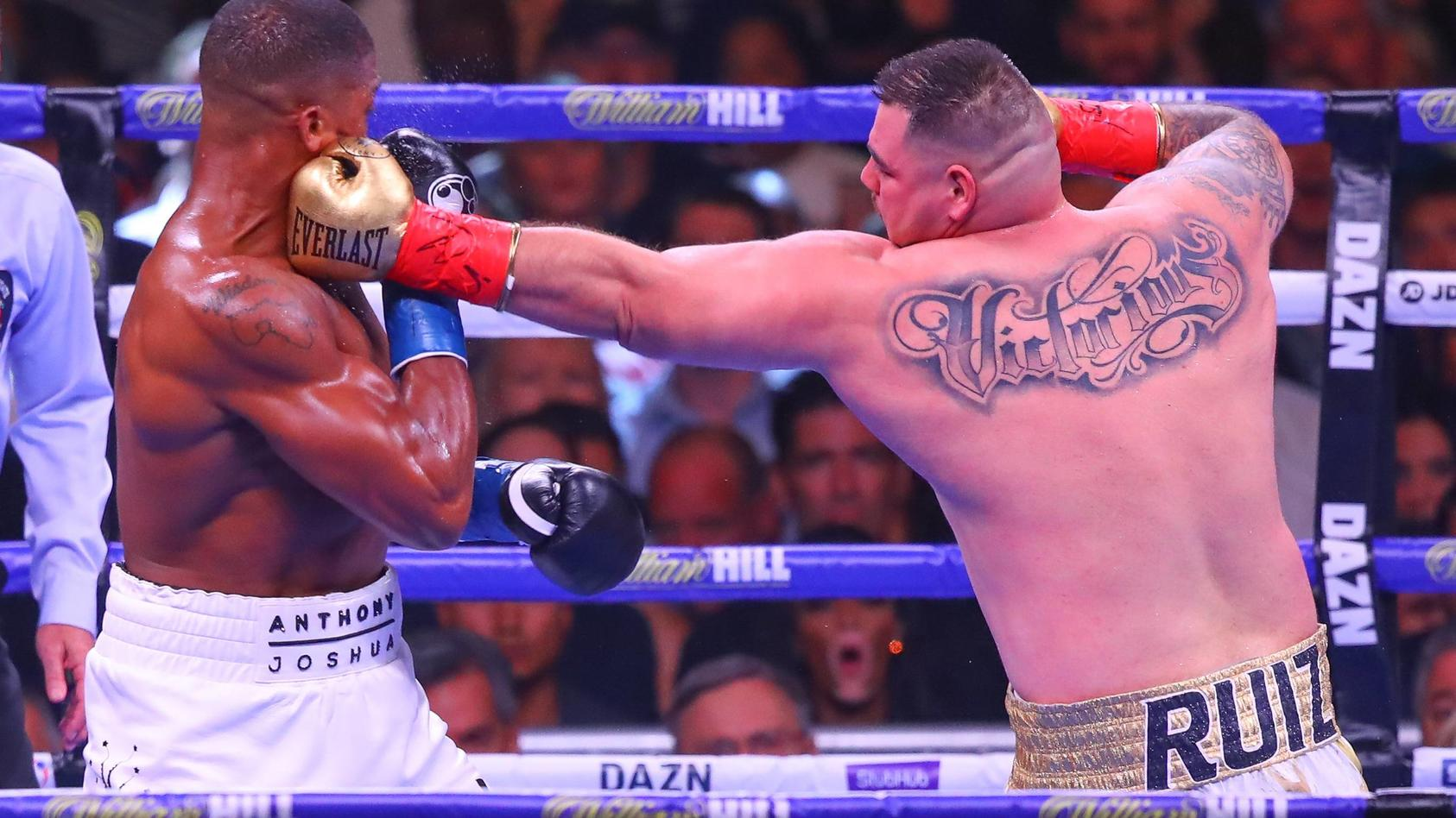NEW YORK NY JUNE 01 Andy Ruiz Jr of California hits Anthony Joshua of England during the second