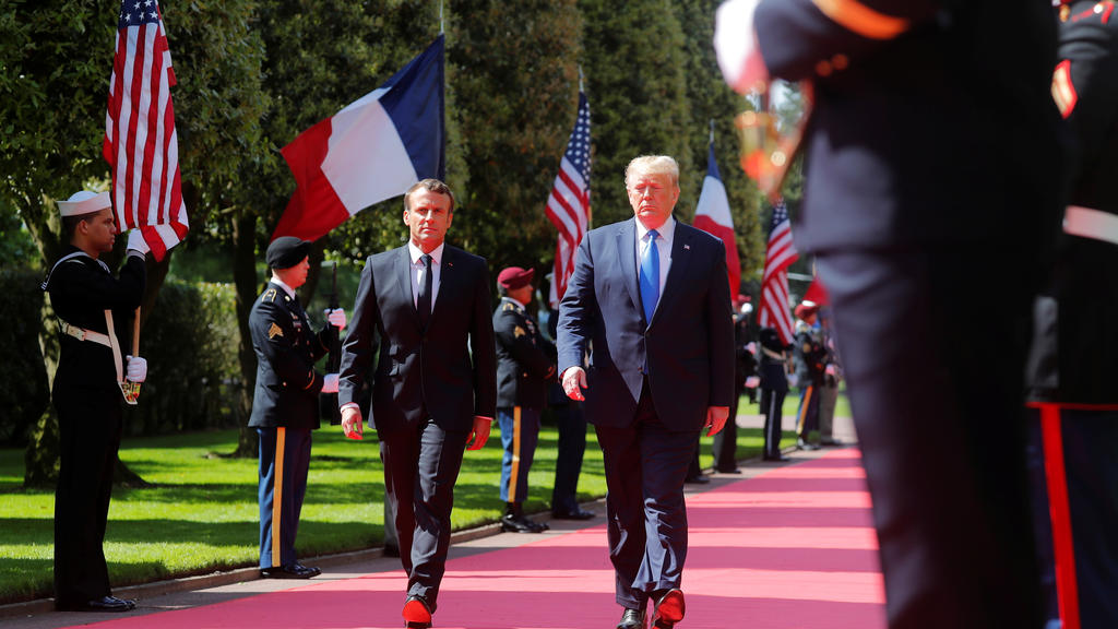 U.S President Donald Trump and French President Emmanuel Macron attend a French-American commemoration ceremony for the 75th anniversary of D-Day at the American cemetery of Colleville-sur-Mer in Normandy, France, June 6, 2019.