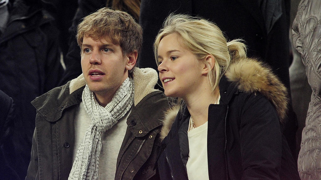 German Formula 1 and Grand Prix driver Sebastian Vettel (L) and his girlfriend Hanna Prater look at the playing field during the Spanish league football match between FC Barcelona and Valencia CF on February 19, 2012, at the Camp Nou stadium in Barce