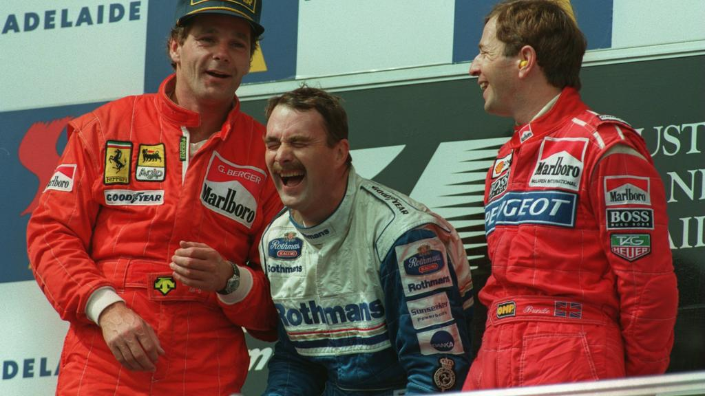 13 NOV 1994:  LEFT TO RIGHT:  SECOND PLACE FINISHER, FERRARI's GERHARD BERGER, WINNER, NIGEL MANSELL AND MARTIN BRUNDLE, THE THIRD PLACE FINISHER, SHARE A JOKE ON THE PODIUM AFTER THE AUSTRALIAN GRAND PRIX IN ADELAIDE. Mandatory Credit: Mike Hewitt/A