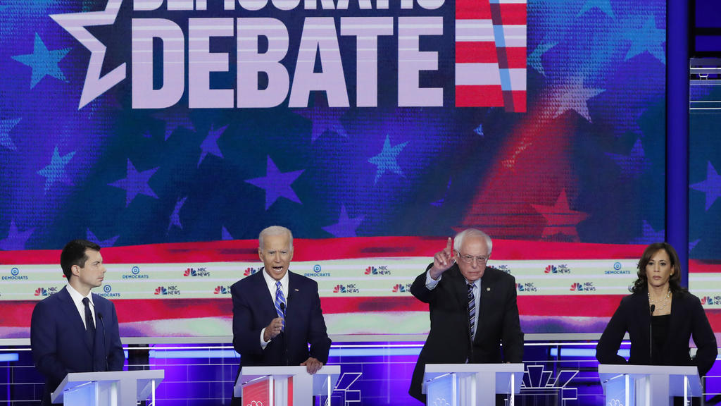 South Bend Mayor Pete Buttigieg, former Vice President Joe Biden, Senator Bernie Sanders and Senator Kamala Harris debate during the second night of the first Democratic presidential candidates debate in Miami, Florida, U.S. June 27, 2019. REUTERS/Mi