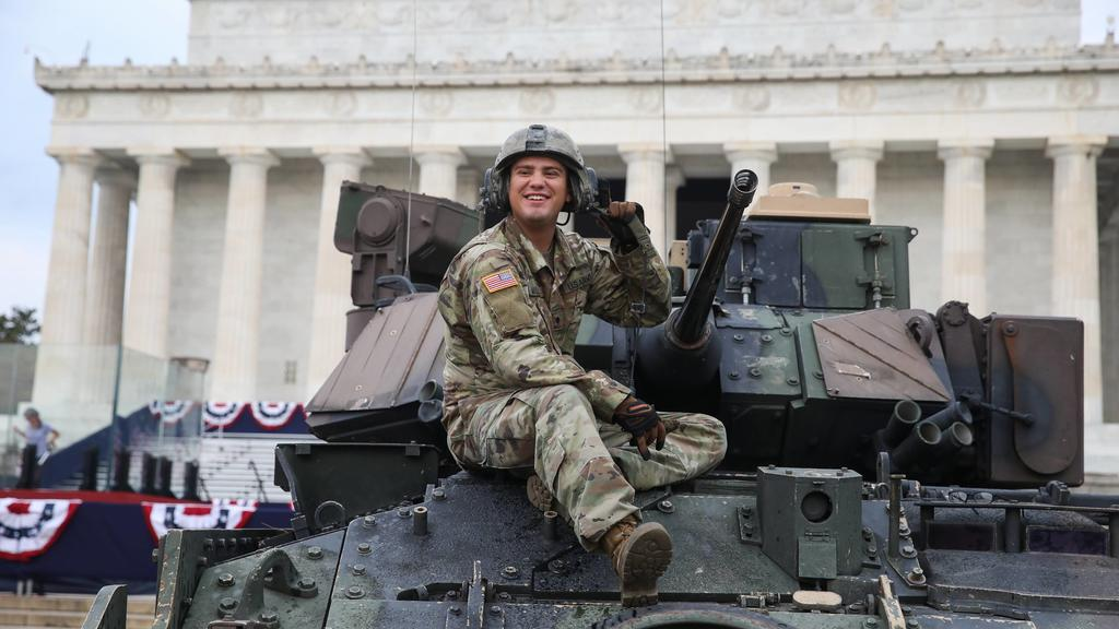 An Army soldier cleans a Bradley Fighting Vehicle at the Lincoln Memorial prior to President Donald Trump s Salute to America Independence Day event honoring the military, Thursday, July 4, 2019, in Washington, D.C. Later today President Trump will h