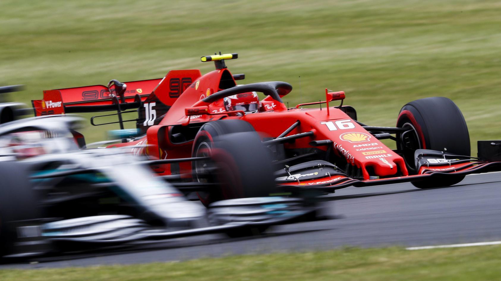 2019 British GP SILVERSTONE UNITED KINGDOM JULY 13 Charles Leclerc Ferrari SF90 passes Lewis H