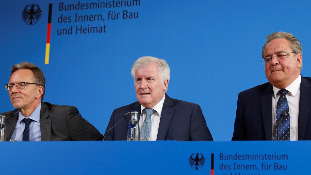 German Interior Minister Horst Seehofer, Holger Muench, Chief Commissioner of Germany's Bundeskriminalamt (BKA) Federal Crime Office and Dieter Romann, Head of German Federal Police, attend a news conference a day after a man killed an 8-year-old boy