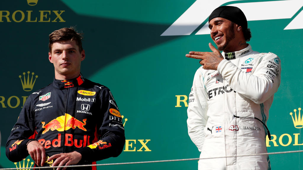 Formula One F1 - Hungarian Grand Prix - Hungaroring, Budapest, Hungary - August 4, 2019   Mercedes' Lewis Hamilton gestures on the podium as he celebrates winning the Hungarian Grand Prix as Red Bull's Max Verstappen looks on   REUTERS/Bernadett Szab