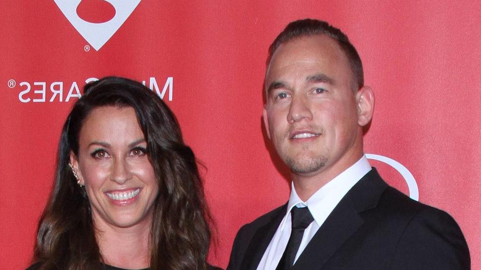 February 6, 2015 - Los Angeles, CA, United States - 6 February 2015 - Los Angeles, California - Mario Treadway, Alanis Morissette. 2015 MusiCares Person Of The Year Gala Honoring Bob Dylan held at the Los Angeles Convention Center. Photo Credit: AdMe