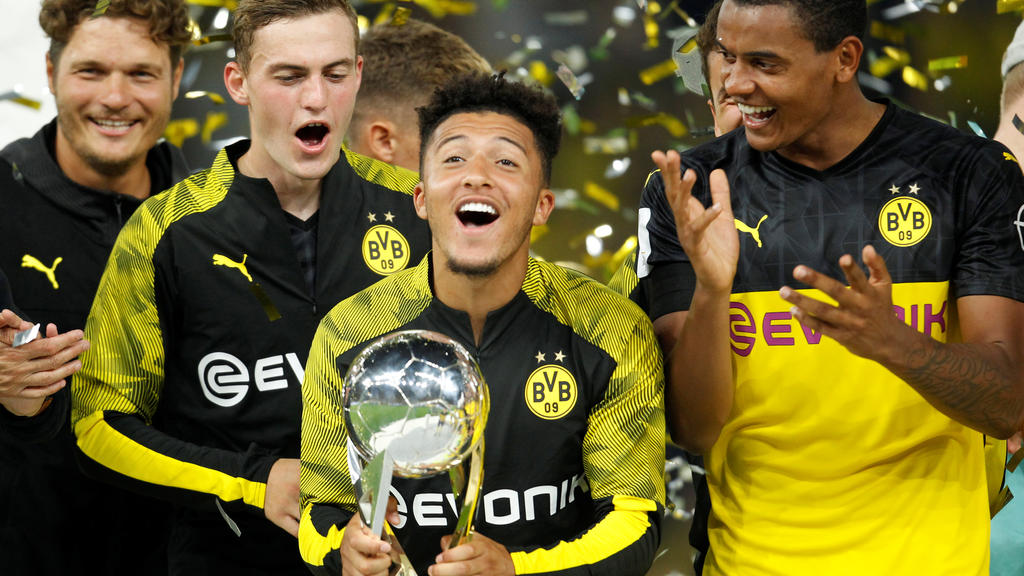Soccer Football - German Super Cup - Borussia Dortmund v Bayern Munich - Signal Iduna Park, Dortmund, Germany - August 3, 2019   Borussia Dortmund's Jadon Sancho celebrates with the trophy after winning the German Super Cup   REUTERS/Leon Kuegeler