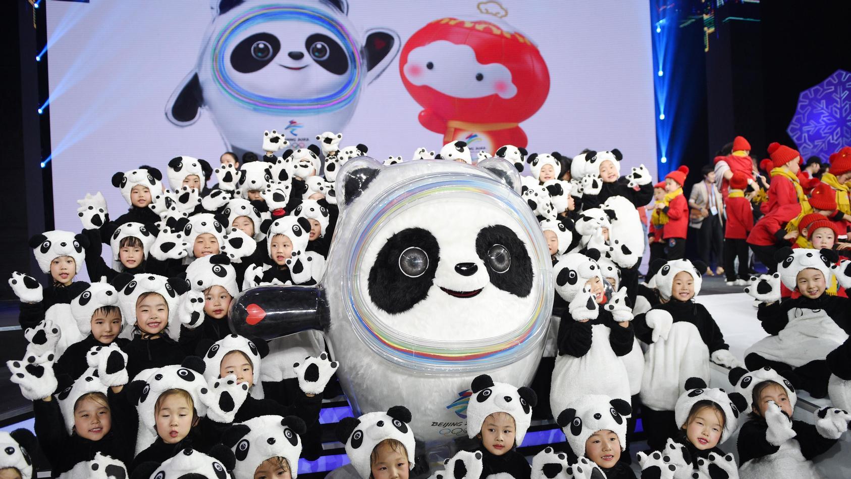 190917 BEIJING Sept 17 2019 Children pose with Bing Dwen Dwen the mascot of Beijing 2022
