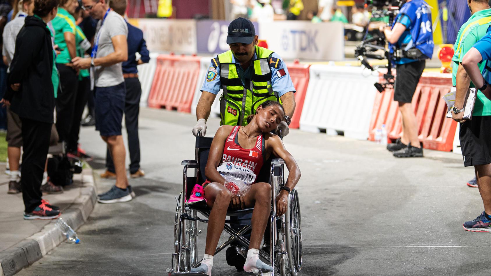 "190927 Desi Jisa Mokonin of Bahrain is being taken care of by medical staff after competing in women""!s marathon during"