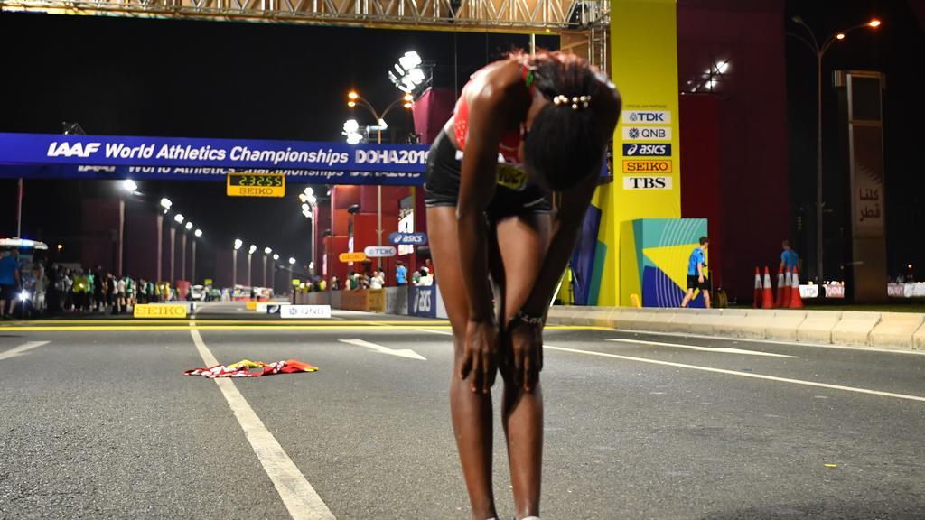 Athletics - World Athletics Championships - Doha 2019 - Women's Marathon - Doha, Qatar - September 28, 2019  Kenya's Ruth Chepngetich celebrates winning the race REUTERS/Dylan Martinez