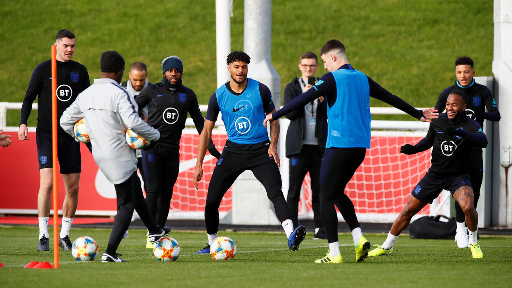 Soccer Football - Euro 2020 Qualifier - England Training - St. George's Park, Burton upon Trent, Britain - October 10, 2019   England's Michael Keane, Raheem Sterling and Tyrone Mings with team mates during training   Action Images via Reuters/Jaso
