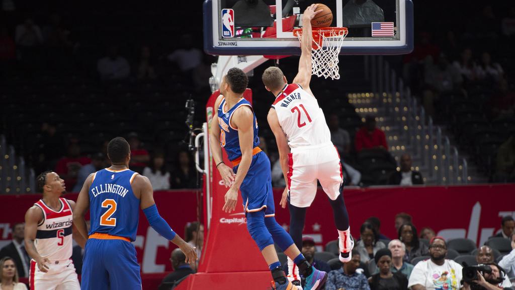 Oct 7, 2019; Washington, DC, USA;  Washington Wizards guard Moritz Wagner (21) dunks as New York Knicks guard Kadeem Allen (0) defends during the first half  at Capital One Arena. Mandatory Credit: Tommy Gilligan-USA TODAY Sports