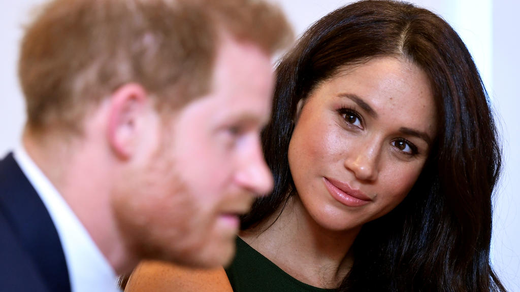 FILE PHOTO: Meghan, Duchess of Sussex, looks at Britain's Prince Harry during the WellChild Awards pre-Ceremony reception in London, Britain, October 15, 2019. REUTERS/Toby Melville/Pool/File Photo