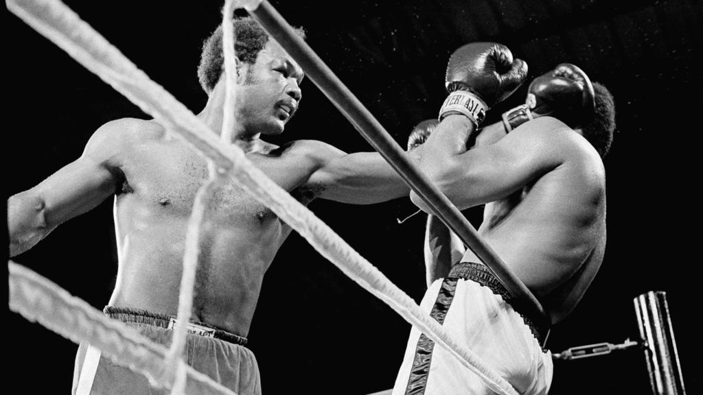 Heavyweight champion George Foreman, left,  has Muhammad Ali on the ropes in the first round of their title bout early in Kinshasa, Zaire, October 30, 1974.    (AP Photo)