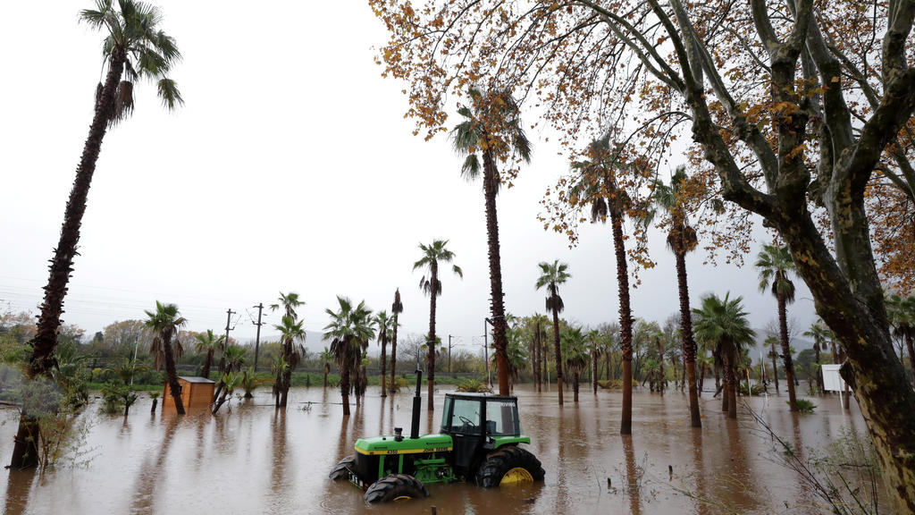 A tractor is seen on a flooded street after heavy rain fall in Roquebrune-sur-Argens, France, November 24, 2019. REUTERS/Eric Gaillard