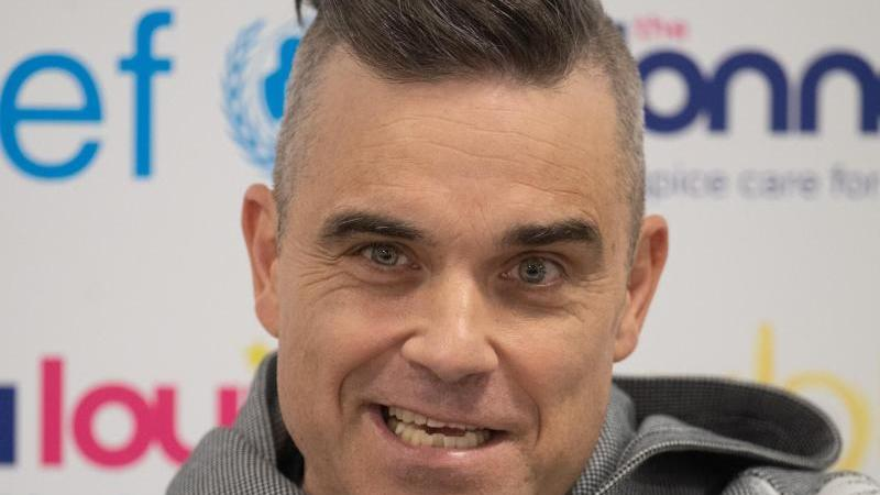 Robbie Williams hält viel von der deutschen Fußball-Nationalmannschaft. Foto: Joe Giddens/PA Wire/dpa