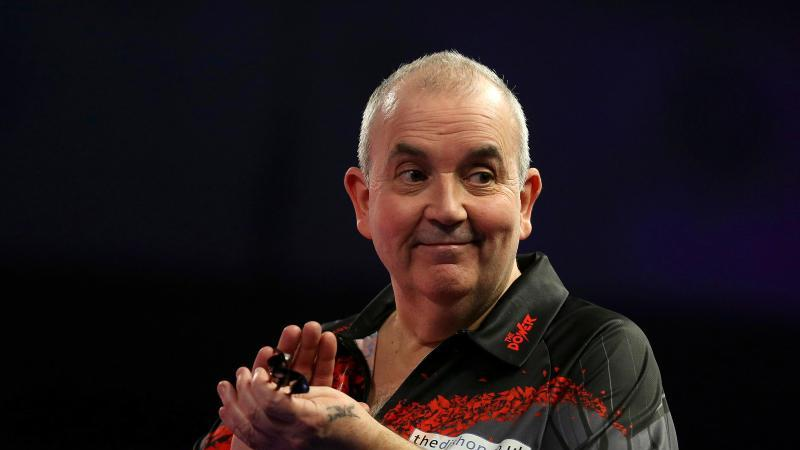 Hat seinen Rücktritt vom aktiven Darts nicht bereut: Rekord-Weltmeister Phil Taylor. Foto: Steven Paston/PA Wire/dpa