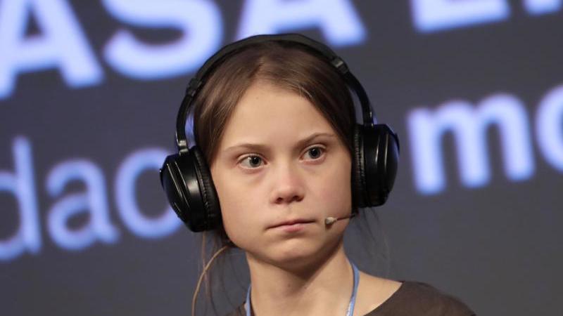Greta Thunberg vor dem großen Klimamarsch im Zentrum der spanischen Hauptstadt Madrid. Foto: Bernat Armangue/AP/dpa