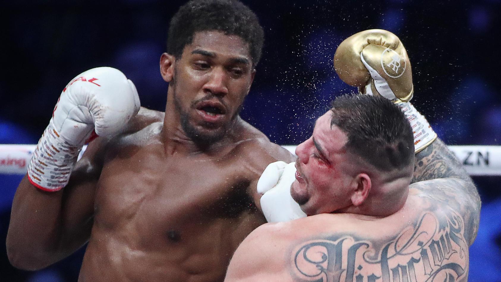 SAUDI ARABIA - DECEMBER 8, 2019: British boxer Anthony Joshua (L) and his American rival Andy Ruiz Jr struggle in their