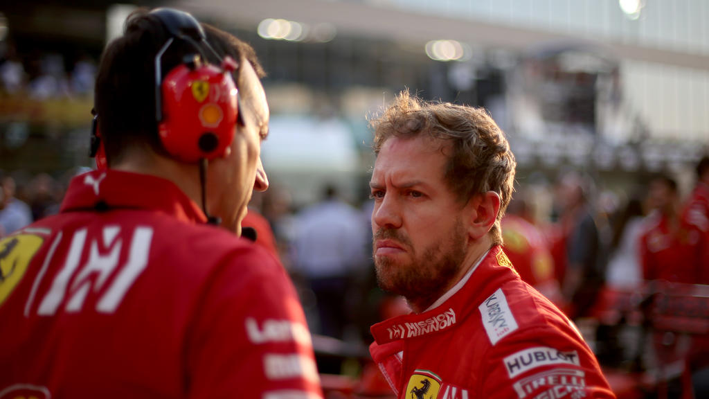 ABU DHABI, UNITED ARAB EMIRATES - DECEMBER 01: Sebastian Vettel of Germany and Ferrari prepares to drive on the grid before the F1 Grand Prix of Abu Dhabi at Yas Marina Circuit on December 01, 2019 in Abu Dhabi, United Arab Emirates. (Photo by Charle