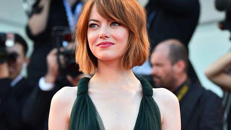 """US actress Emma Stone arrives for the screening of the movie """"Birdman or the Unexpected Virtue of Ignorance"""" presented in competition at the opening ceremony of the 71st Venice Film Festival on August 27, 2014 at Venice Lido.  AFP PHOTO / GABRIEL BOU"""