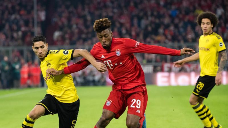 Achraf Hakimi (l) im Zweikampf mit Bayern-Profi Kingsley Coman. Foto: Matthias Balk/dpa