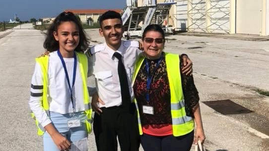 Seth Van Beek (centre) who has become the UK's youngest qualified commercial pilot aged just 18. He is pictured here with his mum Frances Van Beek and sister Hannah Van Beek. See SWNS story SWYpilot. A British teenager ha