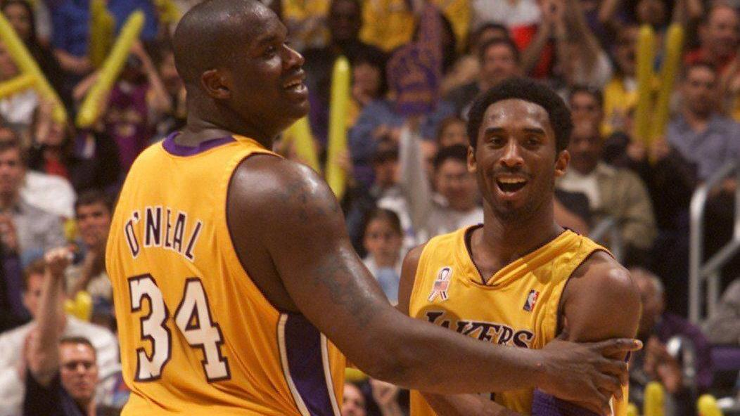Kobe Bryant  March 10, 2002 - U.S. - The Lakers Shaquille O Neal and Kobe Bryant share a laugh during the final minutes