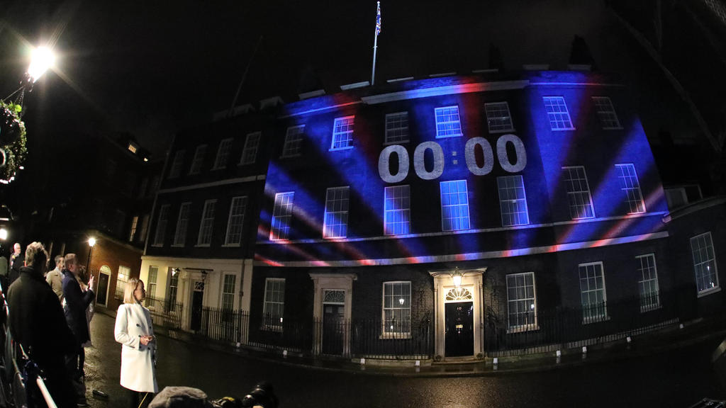 BBC Political editor Laura Kuenssberg watches as the clock counted down to 00:00 as it was projected onto Number 10 Downing Street in Whitehall on the day the UK finally leaves the European Union today at 11.00pm, after a 2016 referendum saw the maj