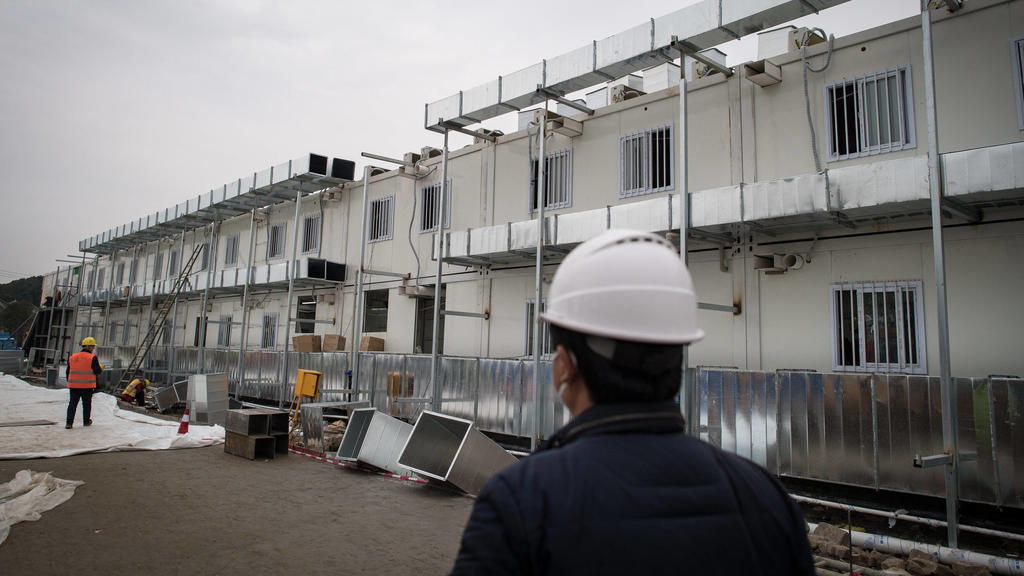 200201 -- WUHAN, Feb. 1, 2020 -- Workers work at the construction site of Huoshenshan Fire God Mountain Hospital in Wuhan, central China s Hubei Province, Feb. 1, 2020. According to the plan, the construction of the hospital will be completed on Feb
