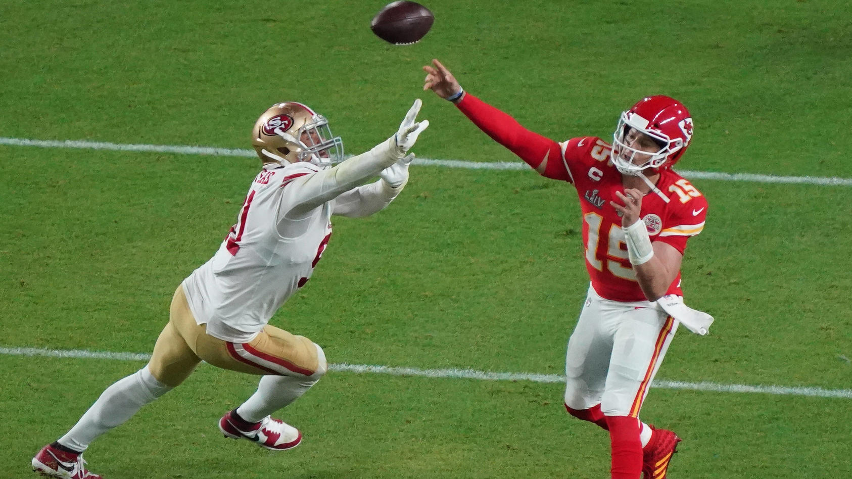 Kansas City Chiefs quarterback Patrick Mahomes (15) throws downfield against the San Francisco 49ers at the Hard Rock S
