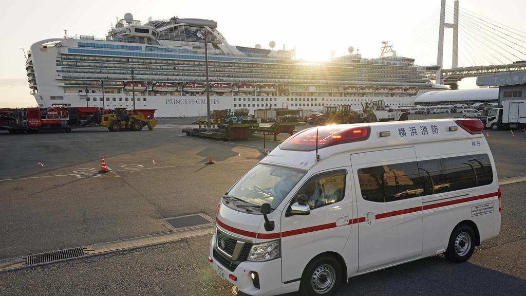 New coronavirus An ambulance moves away from the cruise ship Diamond Princess docked in Yokohama near Tokyo on Feb. 11, 2020. The vessel has been kept in quarantine after the detection of a new coronavirus infection among people aboard. PUBLICATIONx